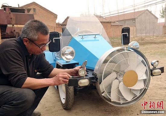 Wind-Powered Car Built By A Chinese farmer