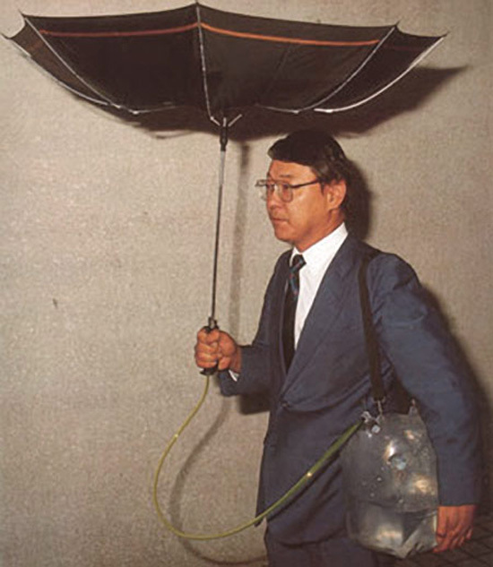 The inverted umbrella connected to a canister.