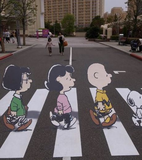 An illusion Of Kids crossing a road.