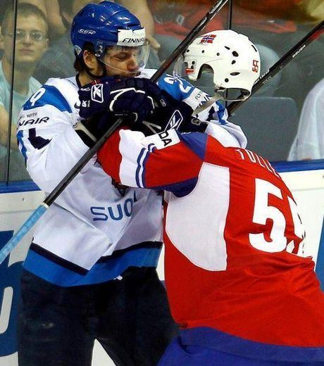 This ice hockey player is not fighting against the invisible man.