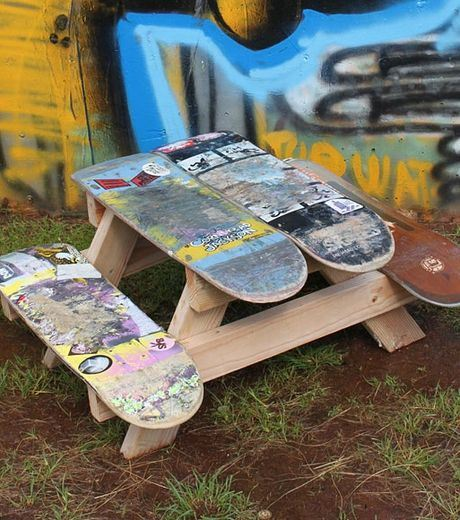 A Children's Table Made From Old Planks Skatboard