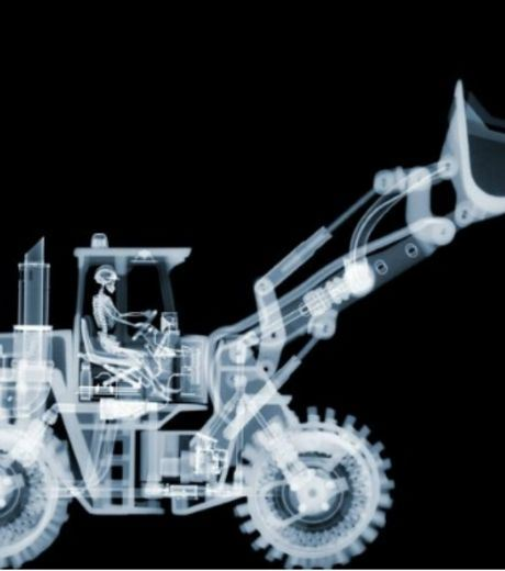 X-Ray Image of A Man Working A Tractor