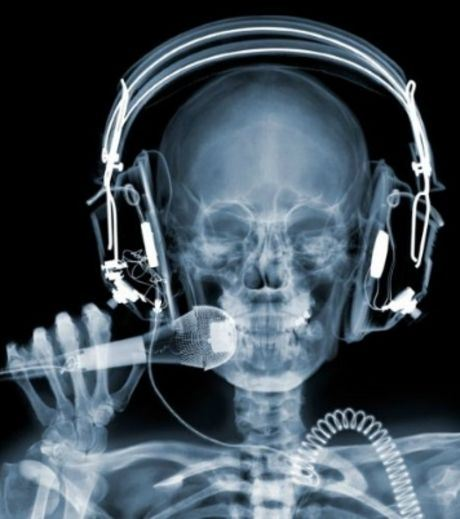 X-Ray Image of A Man Wearing Head Phones And Mic