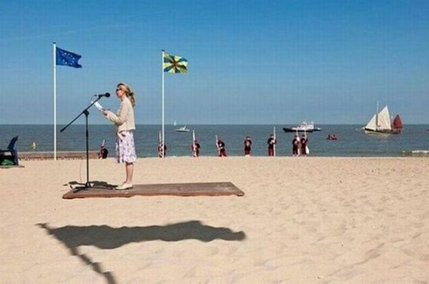 This woman is not riding a flying carpet