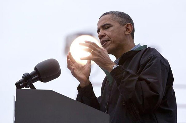 Obama appearing as holding sun in hands
