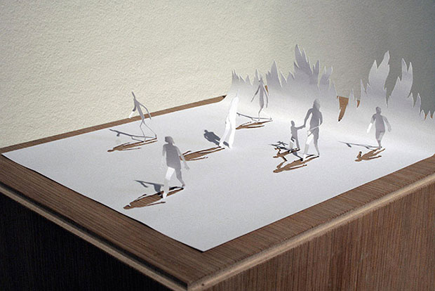 Sculptures of people made of paper