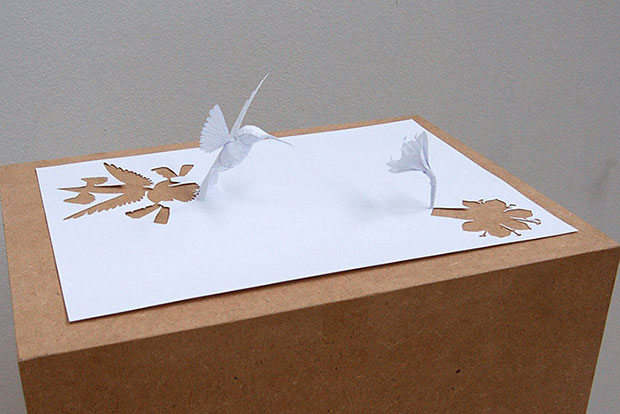 A bird and a flower made from paper