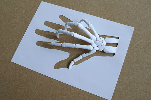 A hand skeleton made from paper