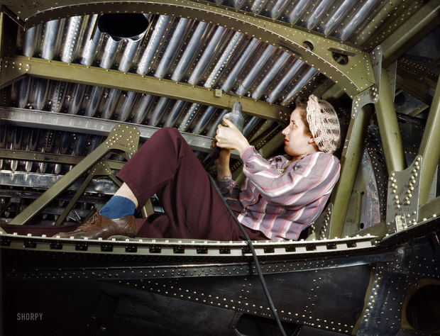 October 1942. An A-20 bomber riveted by a worker.