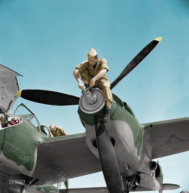 May 1942. Work on the nose of an interceptor aircraft engine. Muroc Lake, California.