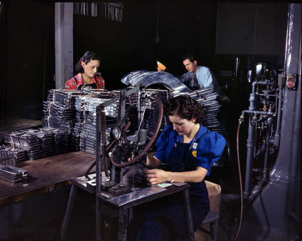 October 1942. Inglewood, California. Parts ready to be assembled are marked with this pneumatic numbering machine.
