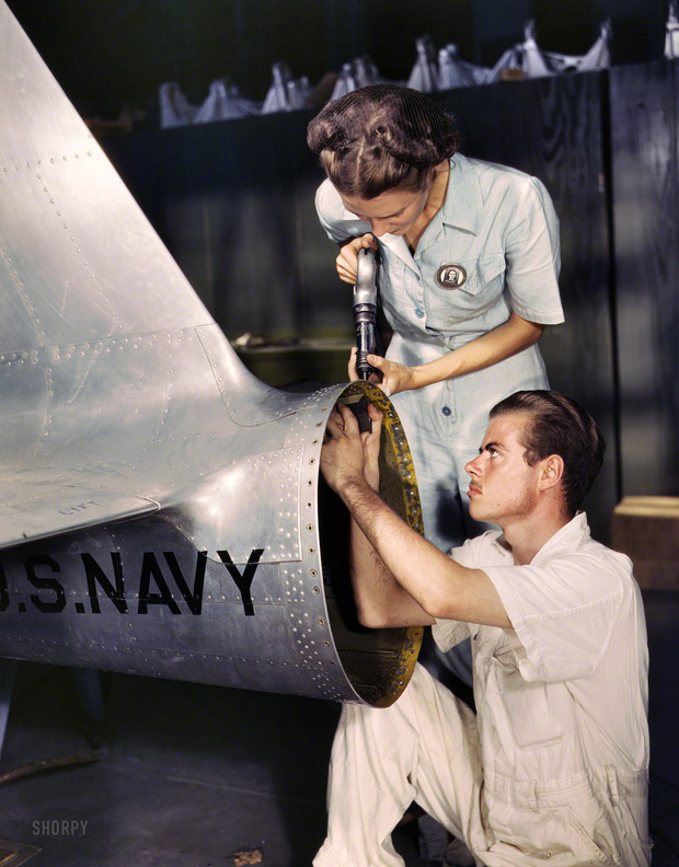 August 1942. Corpus Christi, Texas. Mrs. Virginia Davis, a riveter in the assembly and repairs of the Naval Air Base Department, supervises Chas Potter, a student from Michigan.
