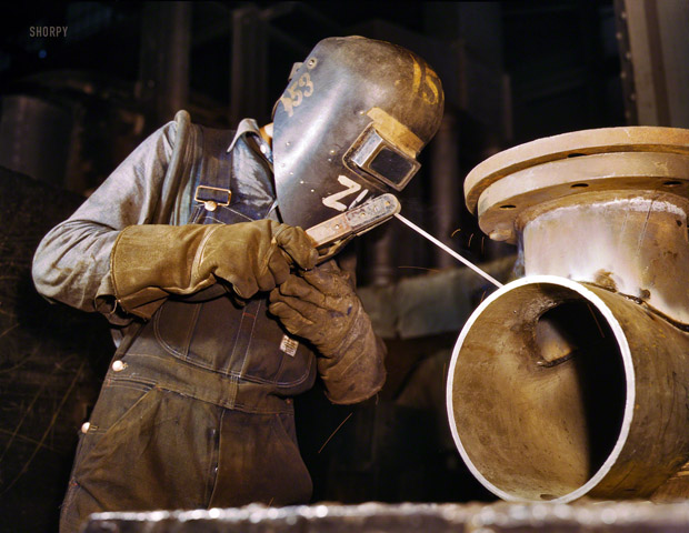 June 1942. A welder produces boilers for boats.