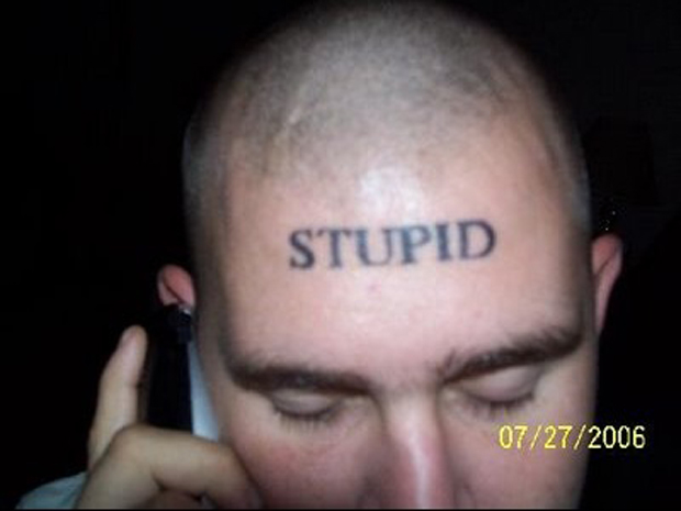 Tattoo of word stupid