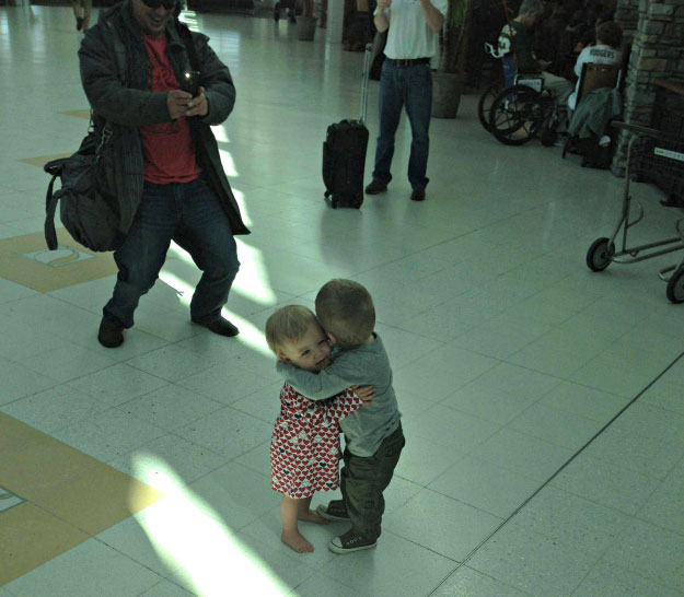 Touching Moments-two stranger toddlers hug
