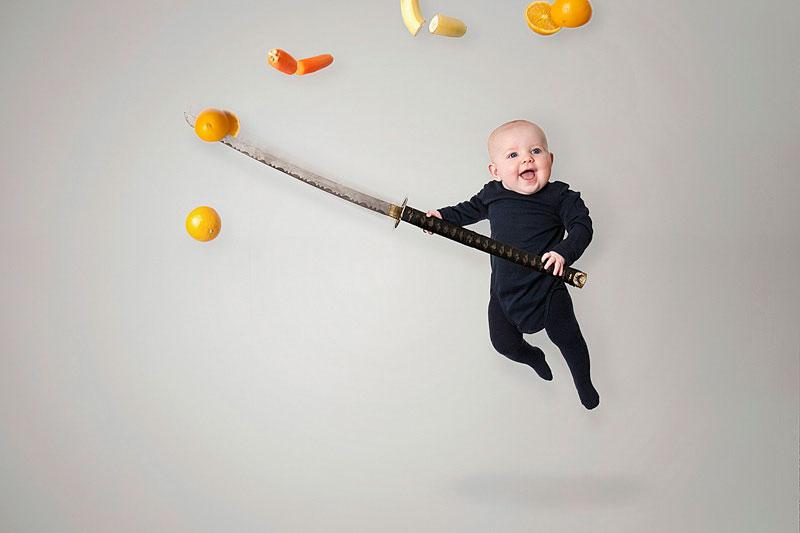 baby holding a ninja sword
