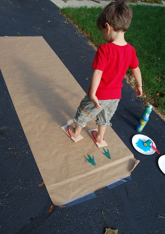 Make dinosaur footprints with flip flops