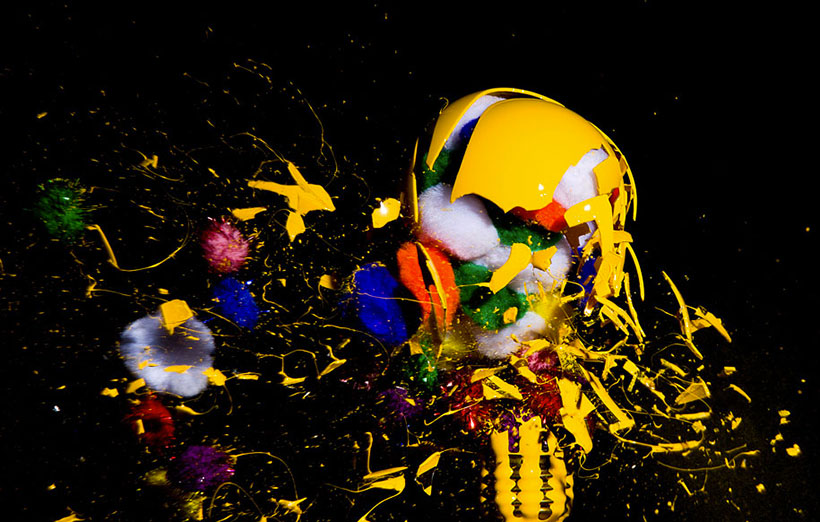 Explosion of colourful material within light bulb