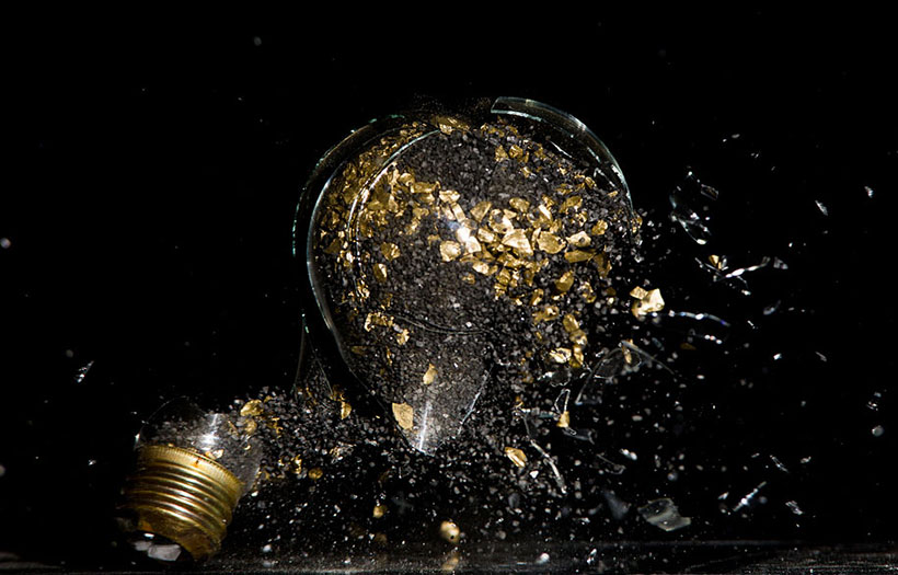 Explosion of material within light bulb