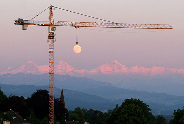 seems as moon is hang through a crane