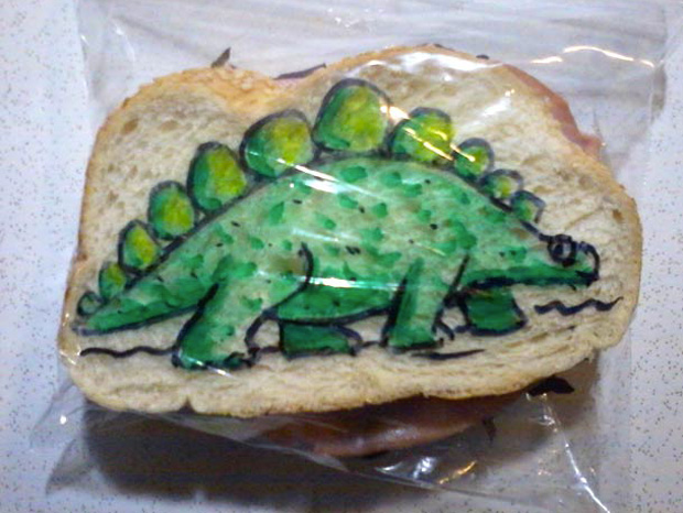 a dinosaur cartoon design on a sandwich