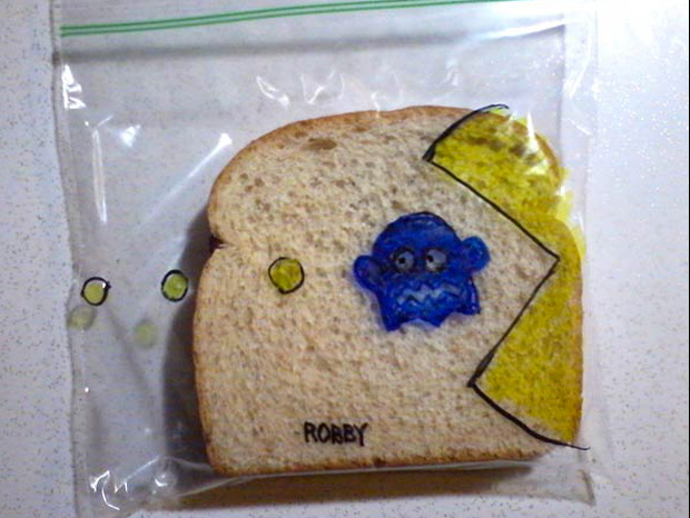 a packman game cartoon design on a sandwich