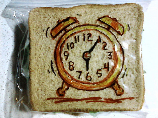a clock design on a sandwich