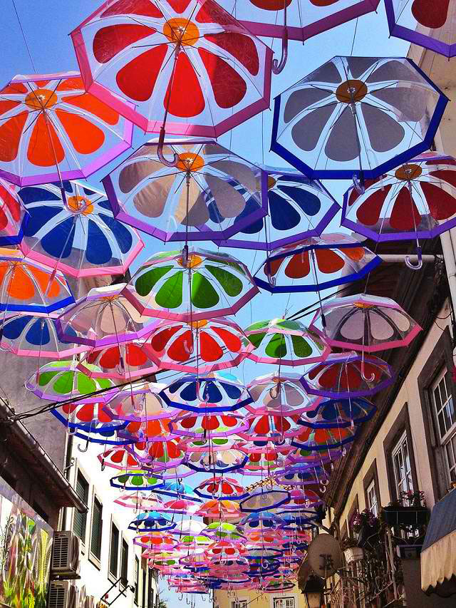 Hundreds Of Colorful Umbrellas Hanging In Agueda Portugal 5