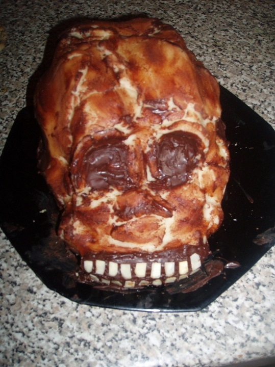 A skeleton with burned face designed cake