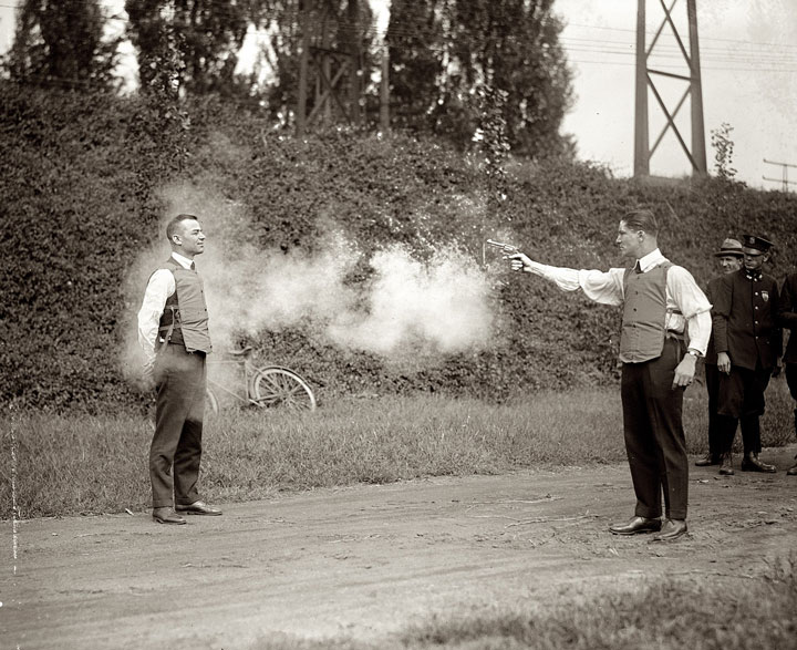 WH Murphy and his partner test their bullet-proof vest, October 13, 1923