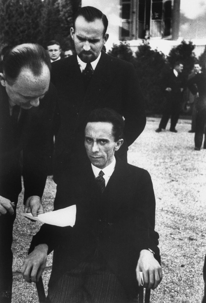 Joseph Goebbels looking suspiciously towards photographer Alfred Eisenstaedt after discovering that he was a Jew, 1933