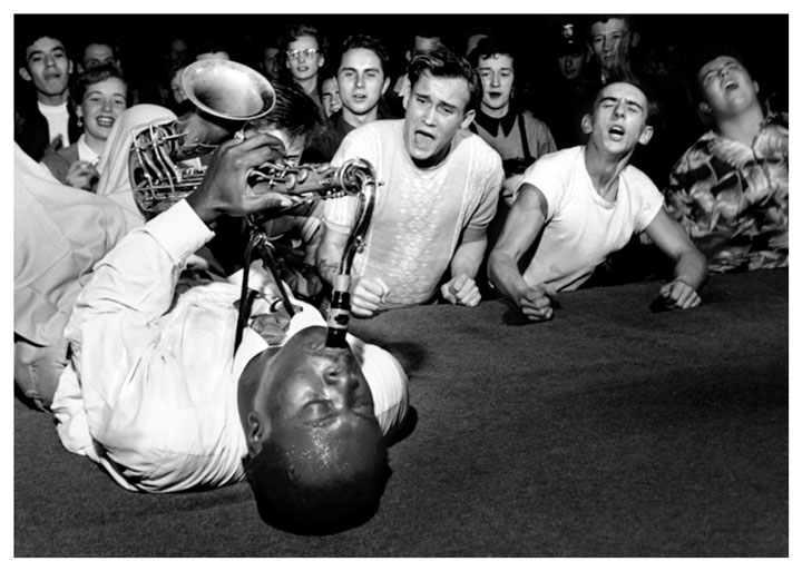 Big Jay McNeely in full frenzy of crowd at Olympic Auditorium, Los Angeles, 1953