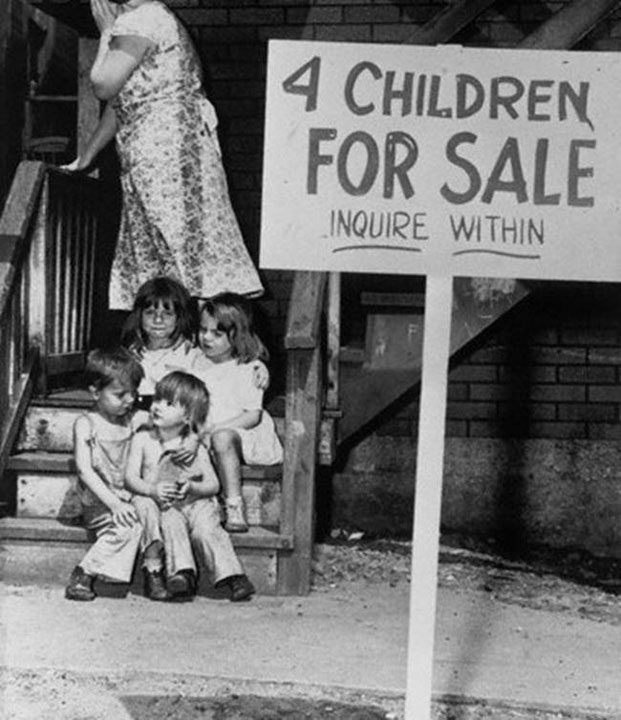 24. A mother shamefully hides her face after putting her children on sale in Chicago in 1948