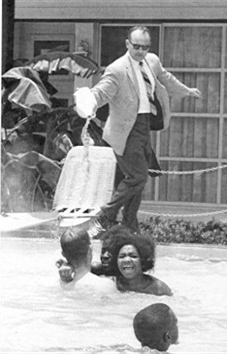 The hotel owner pours acid in the pool while black people swim in it, 1964