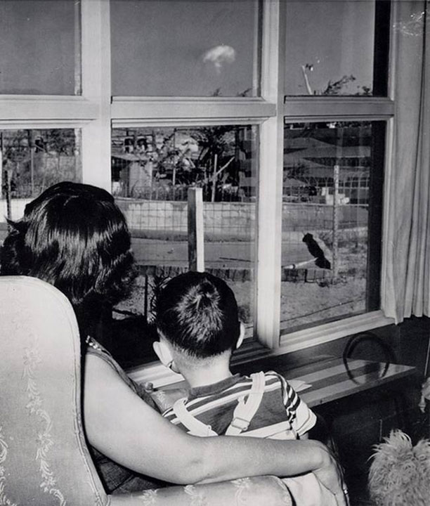 23. Mother and son watching a mushroom cloud after atomic bomb test in Las Vegas in 1953