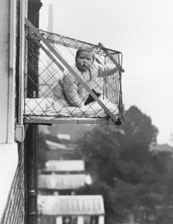 A cage for baby used to give him plenty of natural light and air when you live in an apartment in 1937
