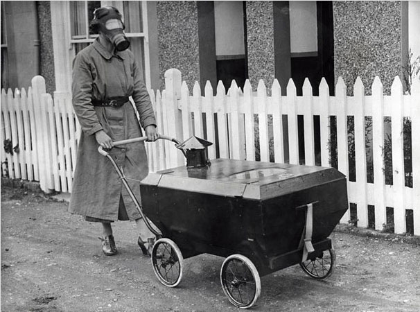 A woman with a stroller that protects against gas attacks in 1938