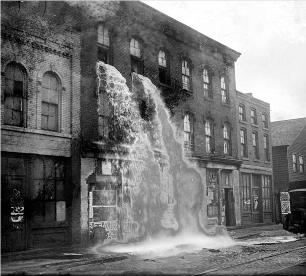 32. Illegal alcohol poured into the streets during the alcohol Prohibition in Detroit in 1929