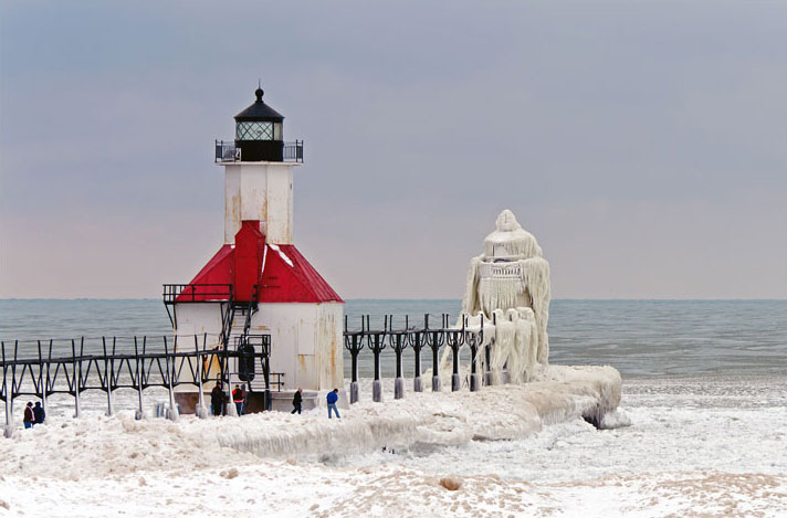 A Pier and two lighthouses On Lake Michigan Turns Into Beautiful Ice Sculptures