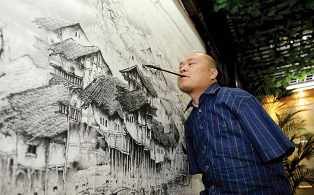 A Chinese Artist Uses Only His Feet and Mouth To Draw Beautiful Paintings-4