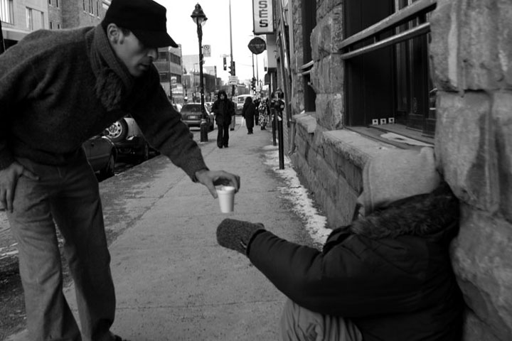 The man who offers a hot chocolate to a person living on the cold street-Emotional Charged Photographs That Prove That Humanity Is Not Yet Lost-8