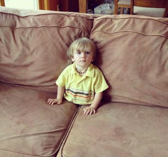 This little boy watching television in a funny position-Children Who Use Their Imagination To Do Weird And Hilarious Things-11