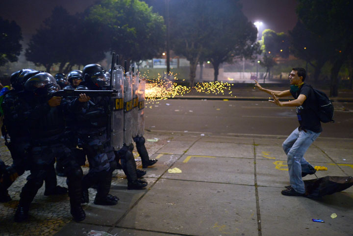 A protester shot at point blank range in Rio de Janeiro, Brazil. -Most Touching Photographs-