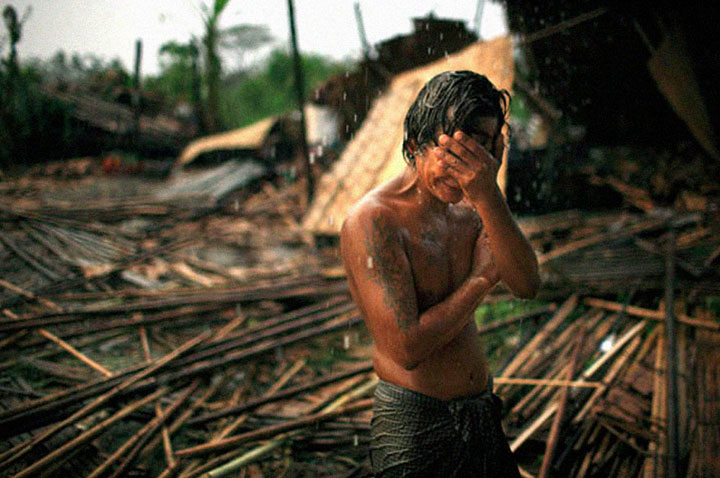 The Hhaing Yu holding weeping at his destroyed house after Cyclone Nargis in May 2008 (Burma)-Most Touching Photographs-11