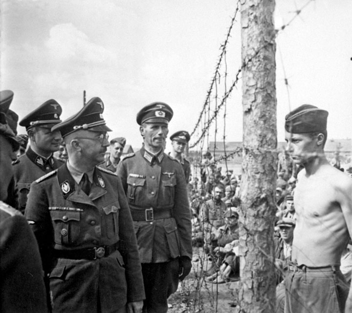 POW Horace Greasley gazes at Heinrich Himmler during the inspection of the camp-Most Touching Photographs-18