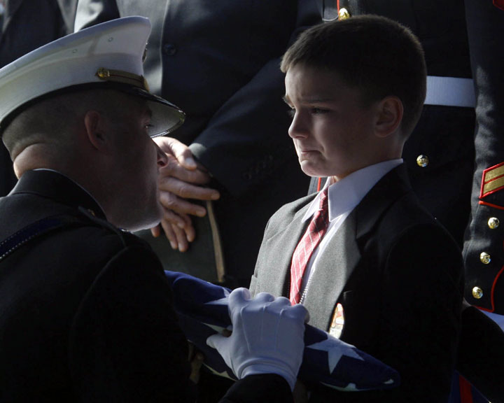 Christian Golczynski, 8 years old, accepts the American flag handed over to him in honor of his father, Sergeant Marc Golczynski.-Most Touching Photographs-28