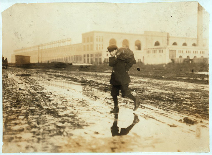 Near a train station, stealing coal in Boston, Massachusetts-USA children-