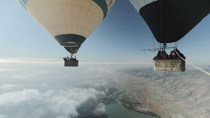 Amazing Stunt Of Walking On A Tightrope Between Two Air Balloons Above Clouds-4