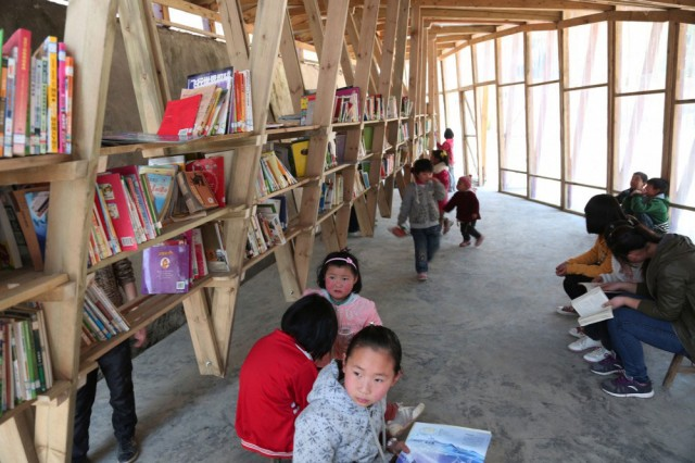 The Pinch: An Amazing Community Library With Double Roof Curved As Slide-3