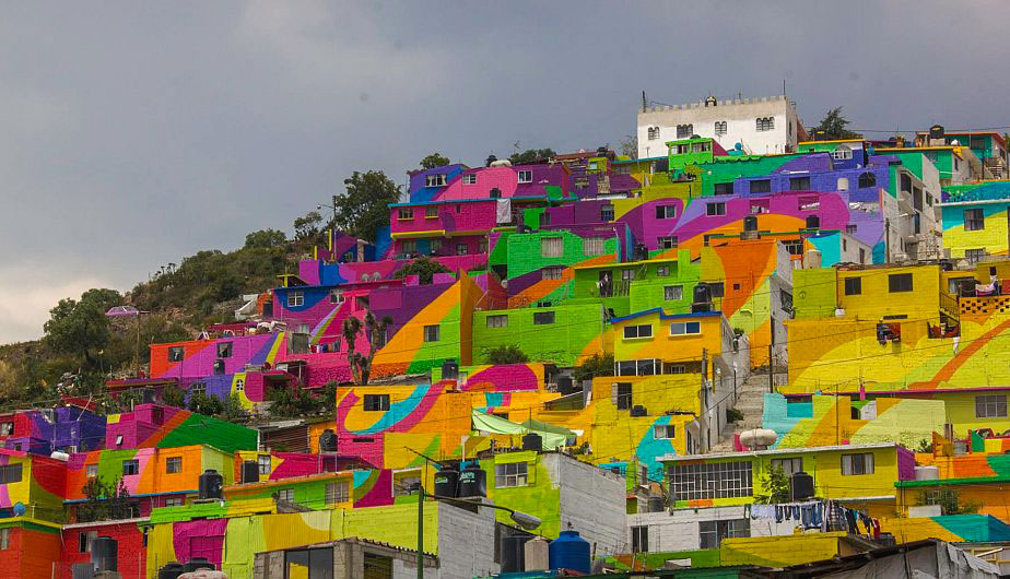 To Unite The Community Against Violence Artists Paint A Mural On 200 Houses -13
